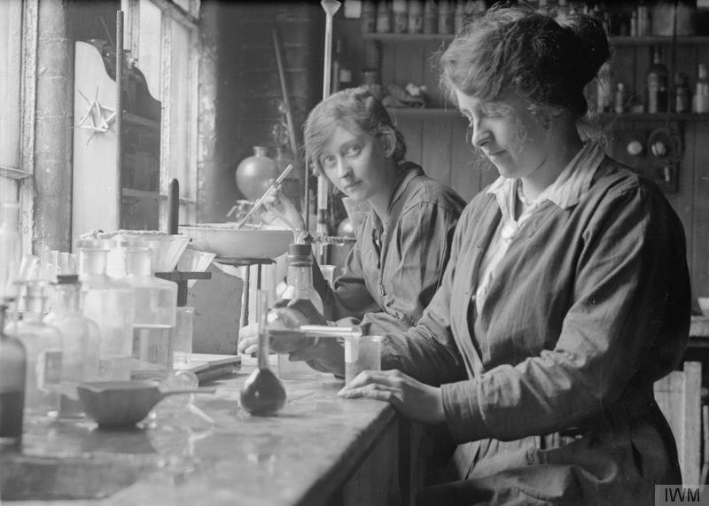 Female chemists in the laboratory of the glucose factory of Nicholls, Nagel & Co. Ltd., Trafford Park, Manchester, September 1918; photograph by George P. Lewis — Wikimedia Commons