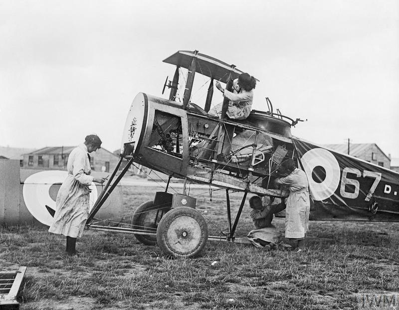 Air Mechanics of the Women's Royal Air Force (WRAF) working on the fuselage of an Avro 504 aircraft, 1918 — Source.